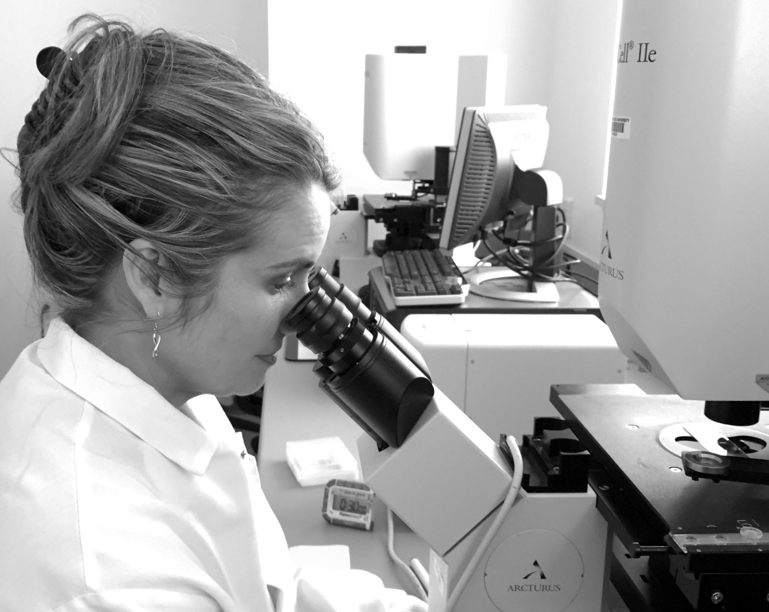 The Side-Out Protocol: A Scientist's Perspective looking into a microscope