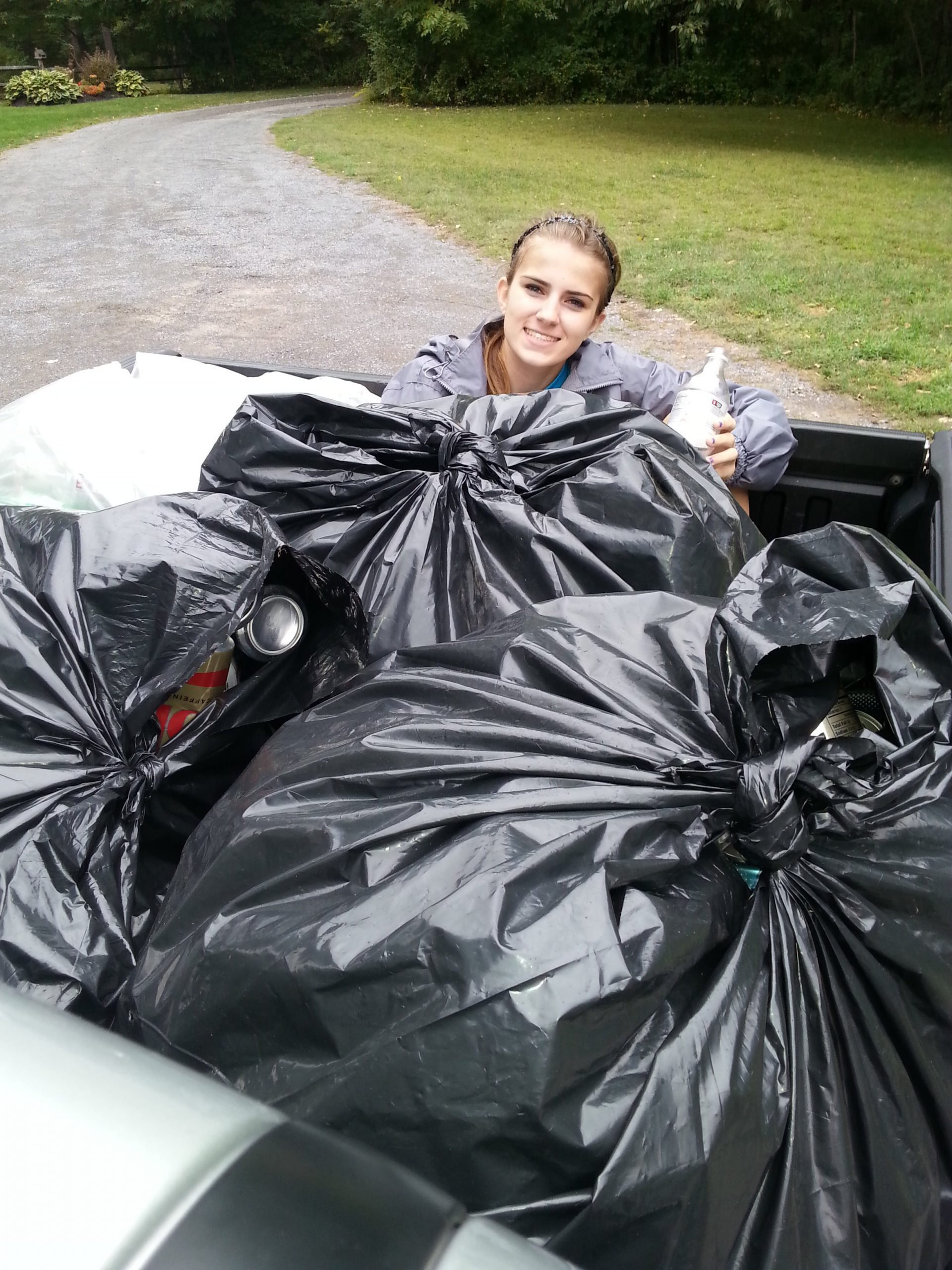 Knowledge is Power: One Student's Mission to Make a Difference collecting bottles